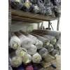 Стеллажи для хранения рулонов ткани в магазине